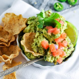 Try to keep the drool off the computer screen people... this guac recipe is SO easy and it features a secret ingredient you won